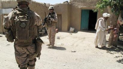 US Marines walk during a patrol in Washer district, Helmand province on 29 June 2011 (AFP Photo / Abdul Malik)