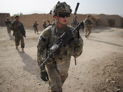 US soldiers from the Charlie Company, 2-87 Infantry, 3rd Brigade Combat Team and Afghan National Army conduct joint patrol at Kandalay village in the southern Afghan province of Kandahar (AFP Photo/Romeo Gacad)