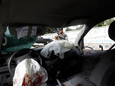 Vehicle hit by a bomb blast in Jalalabad province August 13, 2012 (Reuters / Parwiz)