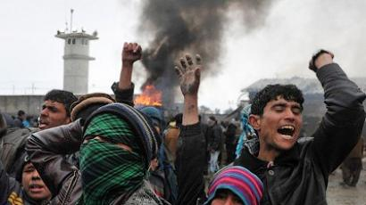 Afghan demonstrators shout anti-US slogans at the gate of Bagram airbase during a protest against Koran desecration on February 21, 2012 at Bagram about 60 kilometres (40 miles) north of Kabul (AFP Photo / Shah Marai)