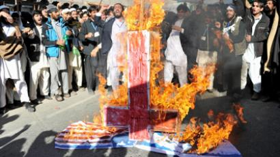 Afghan university students torch a US and Israeli flag during a demonstration against anti Israel and US in Nangarhar province at Jalalabad on November 26, 2012 (AFP Photo / Noorullah Shirzada)