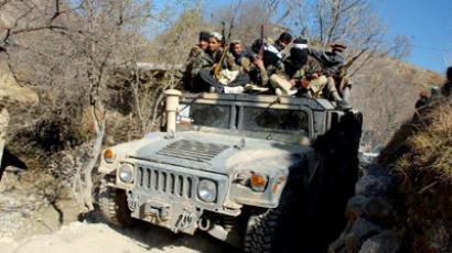 Pakistani Taliban militants patrol in the Mamouzai area of Orakzai Agency, Pakistan (AFP Photo / Tariq Mahmood)