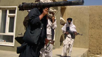 Taliban fighters pose with weapons at an undisclosed location in southern Afghanistan (Reuters / Stringer)