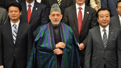 Japanese Foreign Minister Koichiro Gemba, Afghan President Hamid Karzai and Japanese Prime Minister Yoshihiko Noda pose during a group photo session prior to the opening of the Tokyo Conference on Afghanistan in Tokyo on July 8, 2012. (AFP Photo / Kazuhiro Nogi)