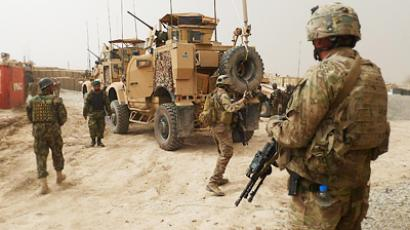 U.S. soldiers keep watch at the entrance of a U.S. base in Panjwai district Kandahar, Afghanistan (Reuters / Stringer)