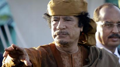 Libyan leader Moamer Kadhafi stands outside his tent in the garden of his Bab al-Aziziya residence after his meeting with African leaders in Tripoli on April 10, 2011 (AFP Photo / Joseph Eid)