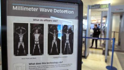 A sign informs travelers about Millimeter Wave Detection technology used in full body scanners at Midway Airport. (AFP Photo / Scott Olson)