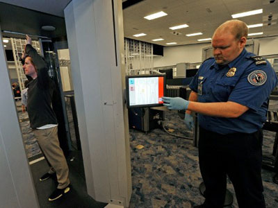 These new-generation full-body scanners were installed after the last underwear attack, but it is not yet clear if the modified bomb can pass through them undetected. (Ethan Miller/Getty Images/AFP)
