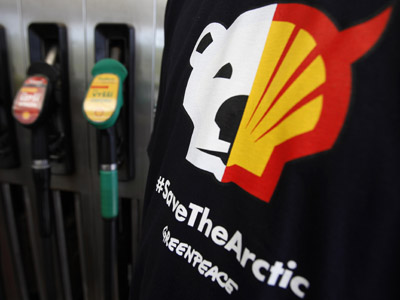 A T-shirt of a Greenpeace environmental activist is seen next to gas pumps at a Shell gas station, May 10, 2012. The activists are protesting against Shell's Arctic oil drilling project in the north of Alaska. (Reuters/David W Cerny)