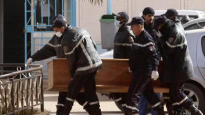Rescue workers carry the coffin of one of the hostages killed during a hostage crisis in a gas plant at the hospital in In Amenas January 21, 2013 (Reuters / Stringer)