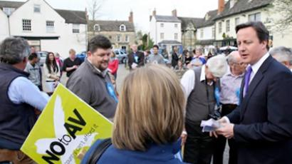 "Britain's Prime Minister David Cameron hands out ""NO to AV"" leaflets in Eynsham, Oxfordshire (AFP Photo / Pool / Steve Parsons)"