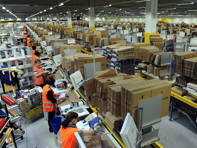 Employees pack parcels at the logistics centre of Amazon in Bad Hersfeld, central Germany.(AFP Photo / Uwe Zocchi)