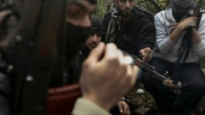 Armed Syrian men, members of the rebel Free Syrian Army (AFP Photo / Ricardo Garcia Vilanova)
