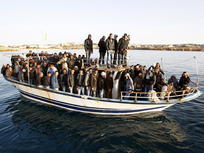 Migrants from North Africa arrive in the southern Italian island of Lampedusa March 7, 2011. (Reuters/Antonio Parrinello)