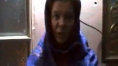 Screenshot from a YouTube video showing Anhar Kochneva in captivity