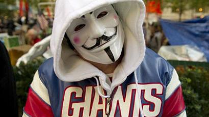 New York : A man wears an Anonymous mask and a NY Giants jacket. (AFP Photo/Don Emmert)