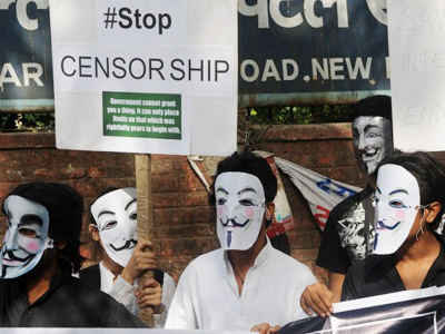 Activists supporting the group Anonymous wear masks as they protest against the Indian Government's increasingly restrictive regulation of the internet in New Delhi on June 9, 2012 (AFP Photo/Raveendran)