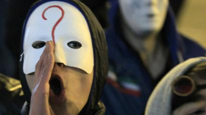 "Members of the hacktivist group ""Anonymous"" take part in a protest in central Brussels January 28, 2012. (Reuters / Yves Herman)"