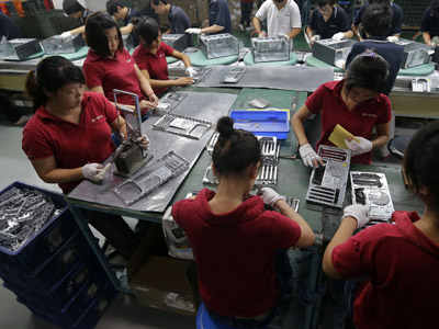 Employees work at a Foxconn factory in Wuhan, Hubei province (Reuters)