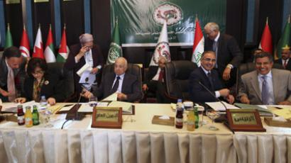 Arab League Secretary-General Nabil Elaraby (seated, 2nd L) and Libya's Economy Minister Ahmad al-Kushali (2nd R) attend an Arab economy, finance and trade ministers meeting as part of the Arab League Summit in Baghdad March 27, 2012. (Reuters / Ali Haider / Pool)