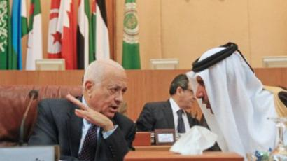 Sheikh Hamad bin Jassem bin Jabr al-Thani (R) speaks to Arab League Secretary General Nabil al-Arabi during an emergency ministerial meeting at the Arab League's Cairo headquarters on the situation in Syria (AFP Photo / Khaled Desouk)