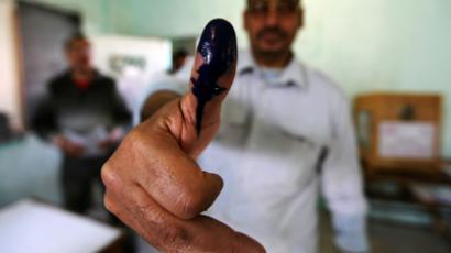 A man shows his ink stained finger after casting his vote at a polling station during parliamentary elections in Cairo November 28, 2011 (Reuters / Amr Abdallah Dalsh)