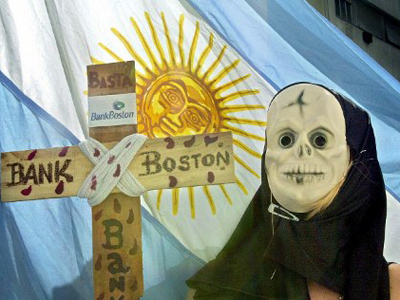 A depositor dressed as Death displays a mock cross for Bank Boston 27 March, 2002 during a protest in Buenos Aires (AFP Photo / Ali Burafi)