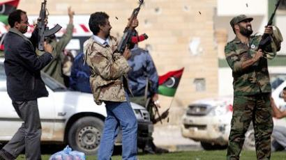 Libyan National Transitional Council (NTC) fighters fire their rifles as they celebrate in the center of Bani Walid on October 17, 2011 after capturing the loyalist bastion following a six-week siege (AFP Photo / Marco Longari)