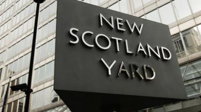 The New Scotland Yard sign stands outside the headquarters of the Metropolitan Police, in central London.(Reuters / Olivia Harris)