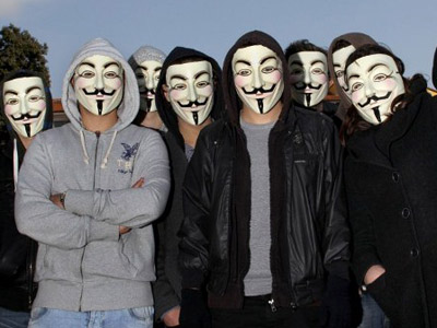 Protesters wearing Anonymous Guy Fawkes masks take part in a demonstration against controversial Anti-Counterfeiting Trade Agreement (ACTA). (AFP Photo / Valery Hache)
