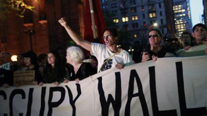 Occupy Wall Street activists shout slogans as they march down Broadway in New York May 1, 2012. (Reuters / Andrew Kelly)