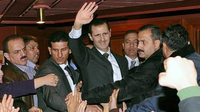 Syria's President Bashar al-Assad (C) waves to his supporters after speaking at the Opera House in Damascus January 6, 2013, in this handout photograph released by Syria's national news agency SANA (Reuters / Khaled Al Hariri)