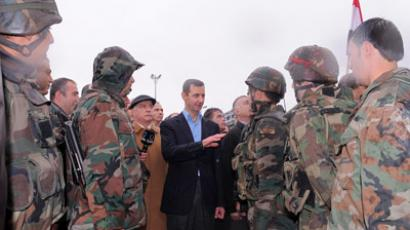 Syria's President Bashar al-Assad (C) speaks to soldiers (Reuters / Sana Sana)
