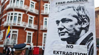 A sign showing a portrait of WikiLeaks founder Julian Assange is held by a supporter outside the Ecuadorian Embassy in London on August 16, 2012 (AFP Photo / Will Oliver)