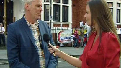 Wikileaks chief press spokesman Kristinn Hrafnsson and RT's correspondent Sara Firth in front of the Ecuadorian embassy in London.