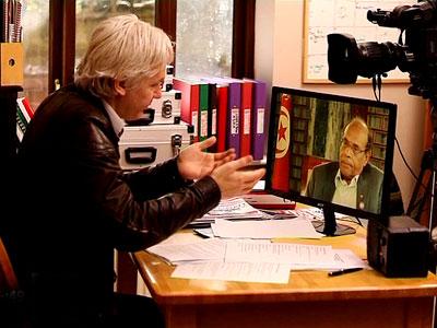 Julian Assange talking to Tunisian President Moncef Marzouki