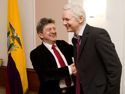 Wikileaks founder Julian Assange (R) shakes hands with French politician Jean Luc Melenchon inside the Ecuadorian embassy in central London, on December 6, 2012.(AFP Photo / Leon Neal)