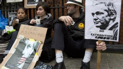 Supporters of WikiLeaks founder Julian Assange sit outside Ecuador's Embassy in London June 22, 2012. (Reuters/Neil Hall)
