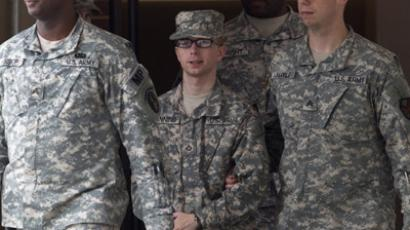 Army Pfc. Bradley Manning (C) is escorted by military police. (Reuters / Benjamin Myers)