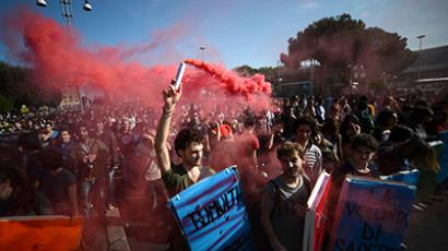 Demonstrators march during a protest on a day of mobilisation against austerity measures by workers in southern Europe on November 14, 2012 in Rome. (AFP Photo / Filippo Monteforte)