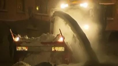 Still frame from video. A snowlough works to clear the roads in Austria.