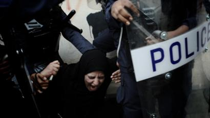 A Bahraini Shiite protester reacts as she is detained by riot police during an anti-government demonstration in the centre of the capital Manama on September 21, 2012 (AFP Photo / Mohammed Al-Shaikh)