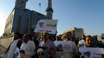 Protesters carry pictures of Shi'ite scholar Isa Qassim during an anti-government protest in the village of Diraz, west of Manama, November 2, 2012 (Reuters / Stringer)