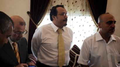 Bahrain medical doctors Mahmmod Asghar (R), Ali Alekri (2R), and Nader Diwani (2L) receive the verdict from an appeals court in Abu Qua'a Village, west of Manama on June 14, 2012. (AFP Photo/Mohammed Al-Shaikh)