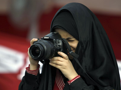 A Bahraini woman takes pictures during an anti-regime protest at Pearl Square, the focal point of demonstrations for over two weeks, in Manama on March 1, 2011 (AFP Photo/Joseph Eid)