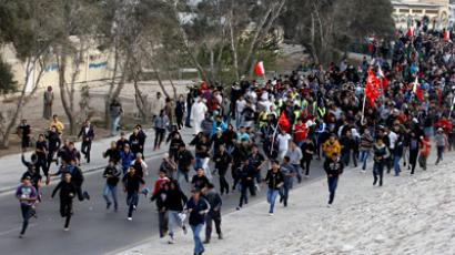 Anti-government protesters run towards Farooq Junction formerly known as Pearl Square after breaking barriers set up by police during a protest in Budaiya west of Manama, February 13, 2012. (REUTERS / Hamad I Mohammed)