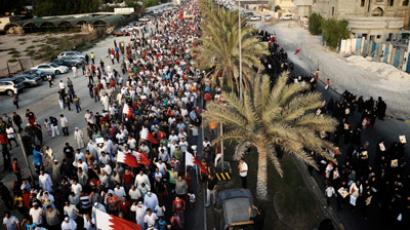 "Bahraini Shiite Muslims waves national flags during an anti-government rally under the slogan ""Freedom and Democracy"" in the village of Shakhora, west of the capital Manama, on August 31, 2012. (AFP Photo/Mohammed Al-Shaikh)"