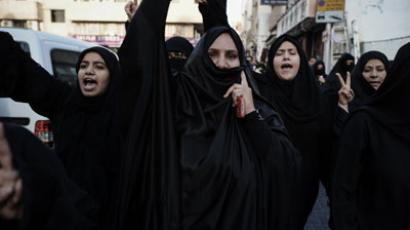 Bahraini Shiite Muslim women shout slogans during an anti-regime demonstration in Manama on January 25, 2013.(AFP Photo / Mohammed Al-Shakh)