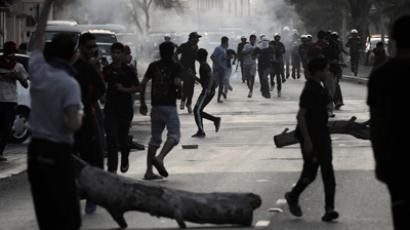 Bahraini Shiite protesters clash with riot police (AFP Photo / Mohammed Al-Shaikh); Youtube video courtesy of alimax1