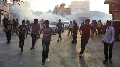 Bahraini police fire tear-gas at peaceful crowd (Photo by ‏@SAIDYOUSIF, YouTube video by malzhra)